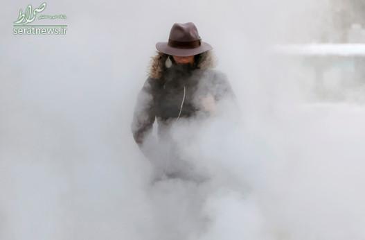 عبور یک زن از بخار تهویه یک زیرزمین در دمای منهای 4 درجه فارنهایت ـ بخارست رومانی