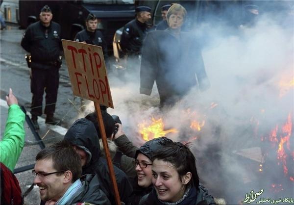 عکس مرکل به آتش کشیده شد +تصاویر