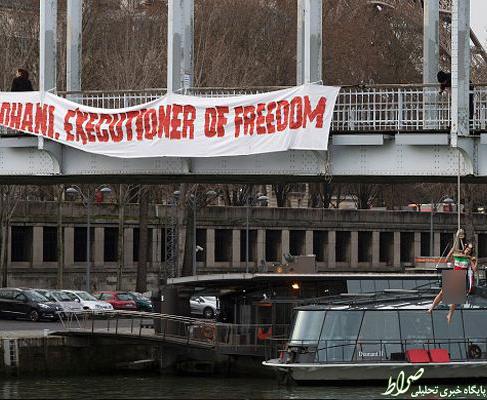 اعتراض یک زن به سفر روحانی به پاریس +تصاویر