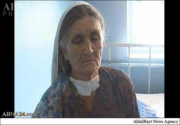 داعش گلوی پیرزن افغان را برید+عکس