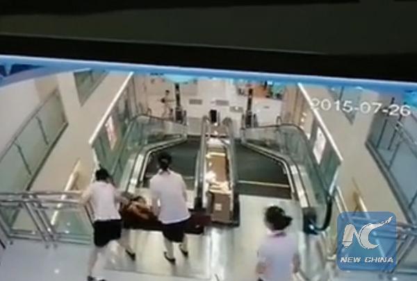 مرگ دلخراش زن چینی با پله برقی+تصاویر